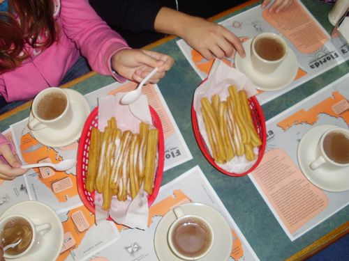 table of churros con chocolate
