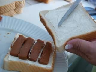 Spread guava & cream cheese on bread