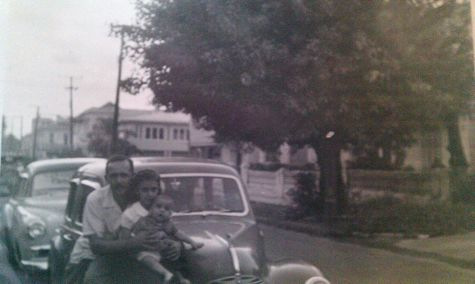 My dad, sister and brother on car in front of the house