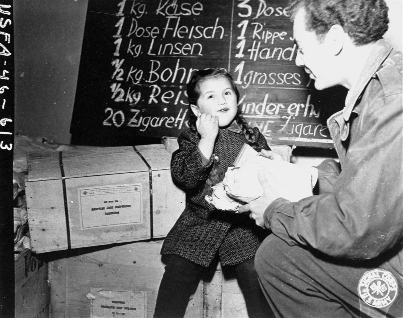 Click photo to download. Caption: Harry Weinsaft of the American Jewish Joint Distribution Committee gives food to 3-year-old Renati Rulhater, a Jewish DP in Austria, sometime between 1945 and 1946—a time when the Jewish Federation system's overseas funding split favored JDC. Credit: U.S. Government.