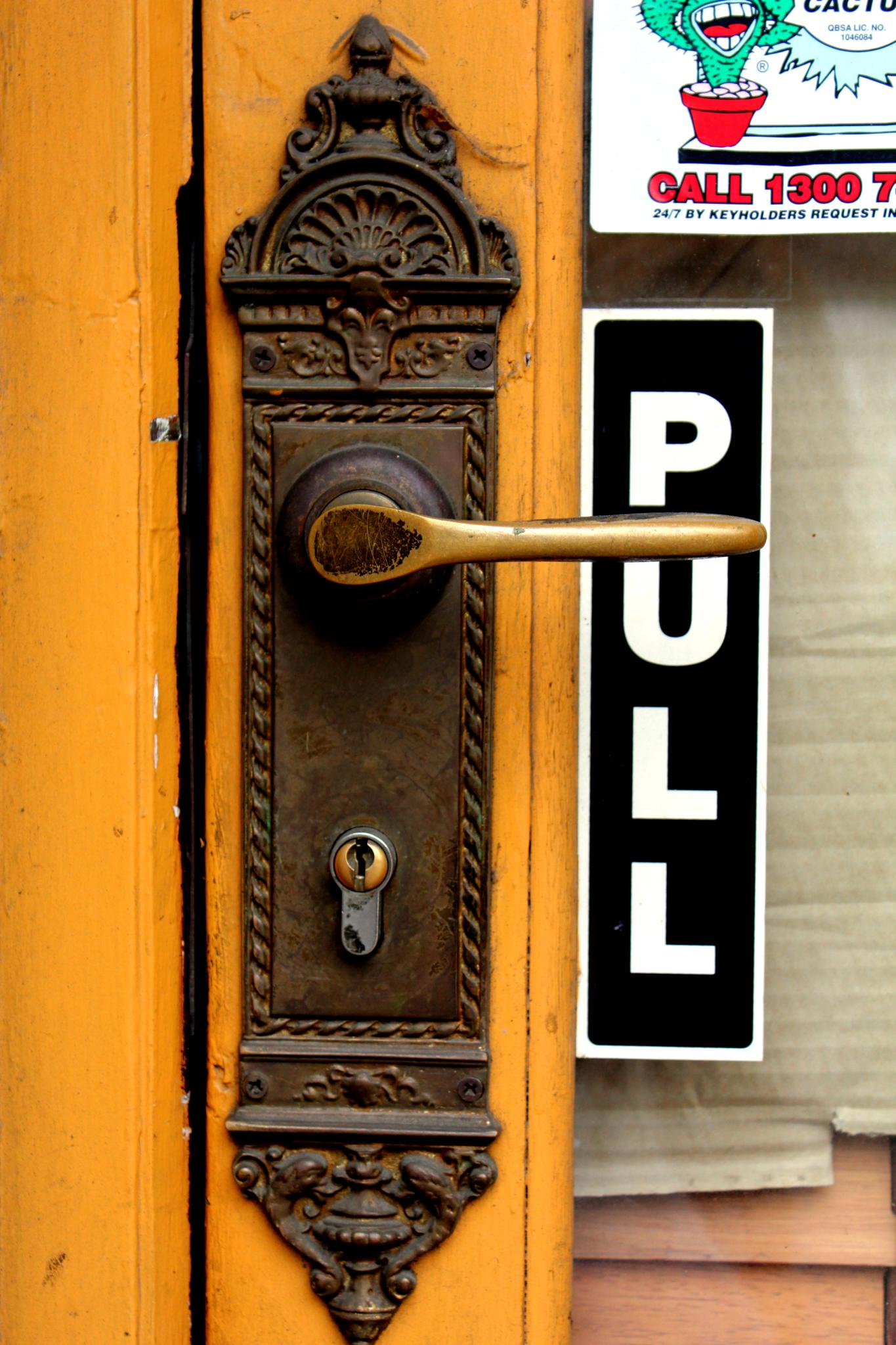 Lever Door Handle With 'Pull' Sign