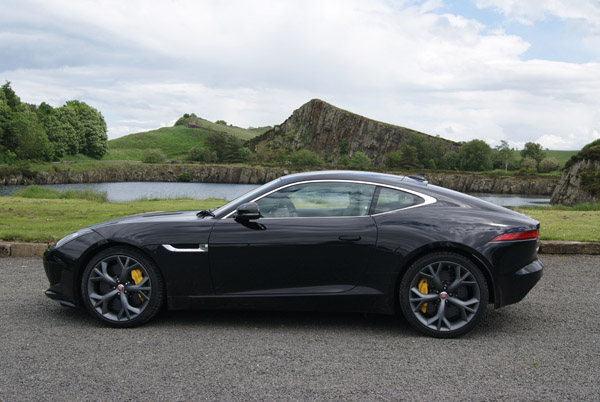 The F-TYPE coupé in Northumberland with Hadrian's wall in the distance