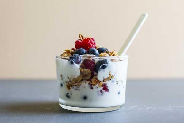 Lemon Cheesecake Mousse with Berries & Candied Almonds | edibleperspective.com #vegan #glutenfree