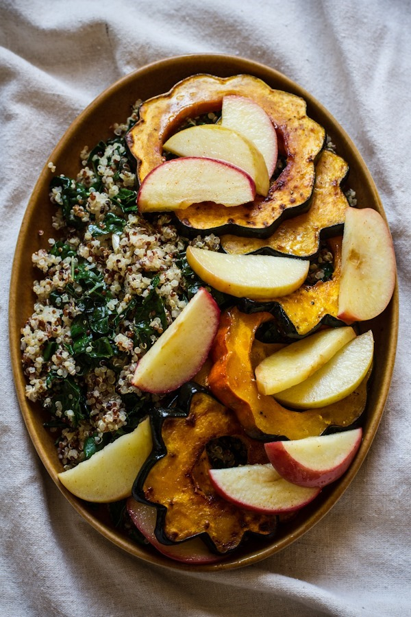 Roasted Acorn Squash and Apples with Quinoa, Kale, and Tahini Maple Dressing | edibleperspective.com