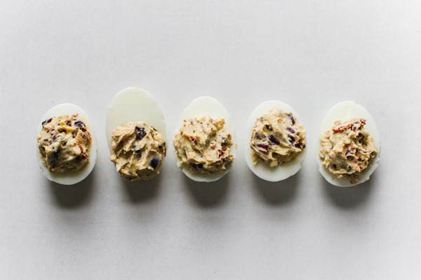 Greek Stuffed Deviled Eggs (mayo free) | edibleperspective.com