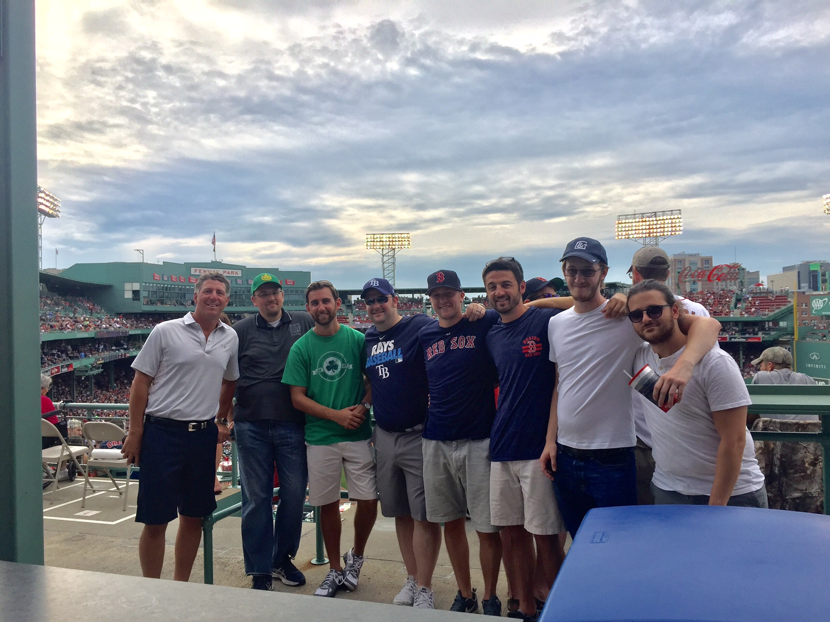 Crunched accounting team members at a redsox baseball game