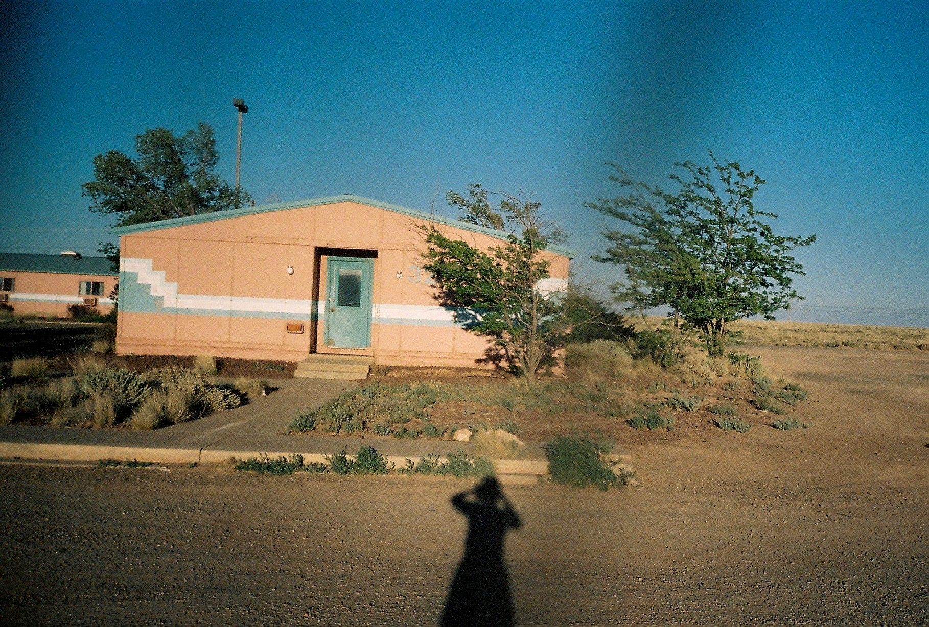 Exterior of a house with shadow of woman