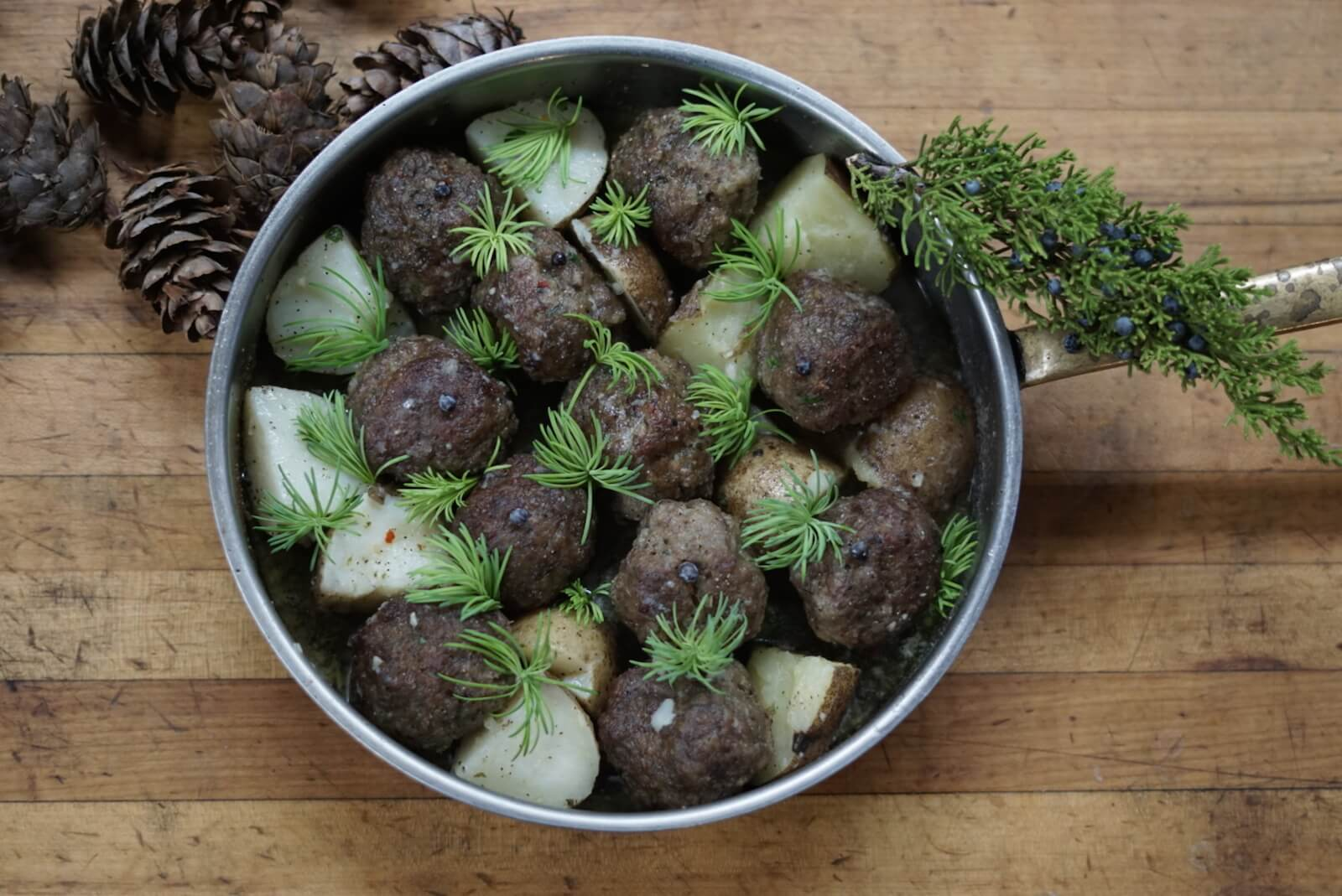 Recipe for Nordic Meatballs served with potatoes and pine sprouts