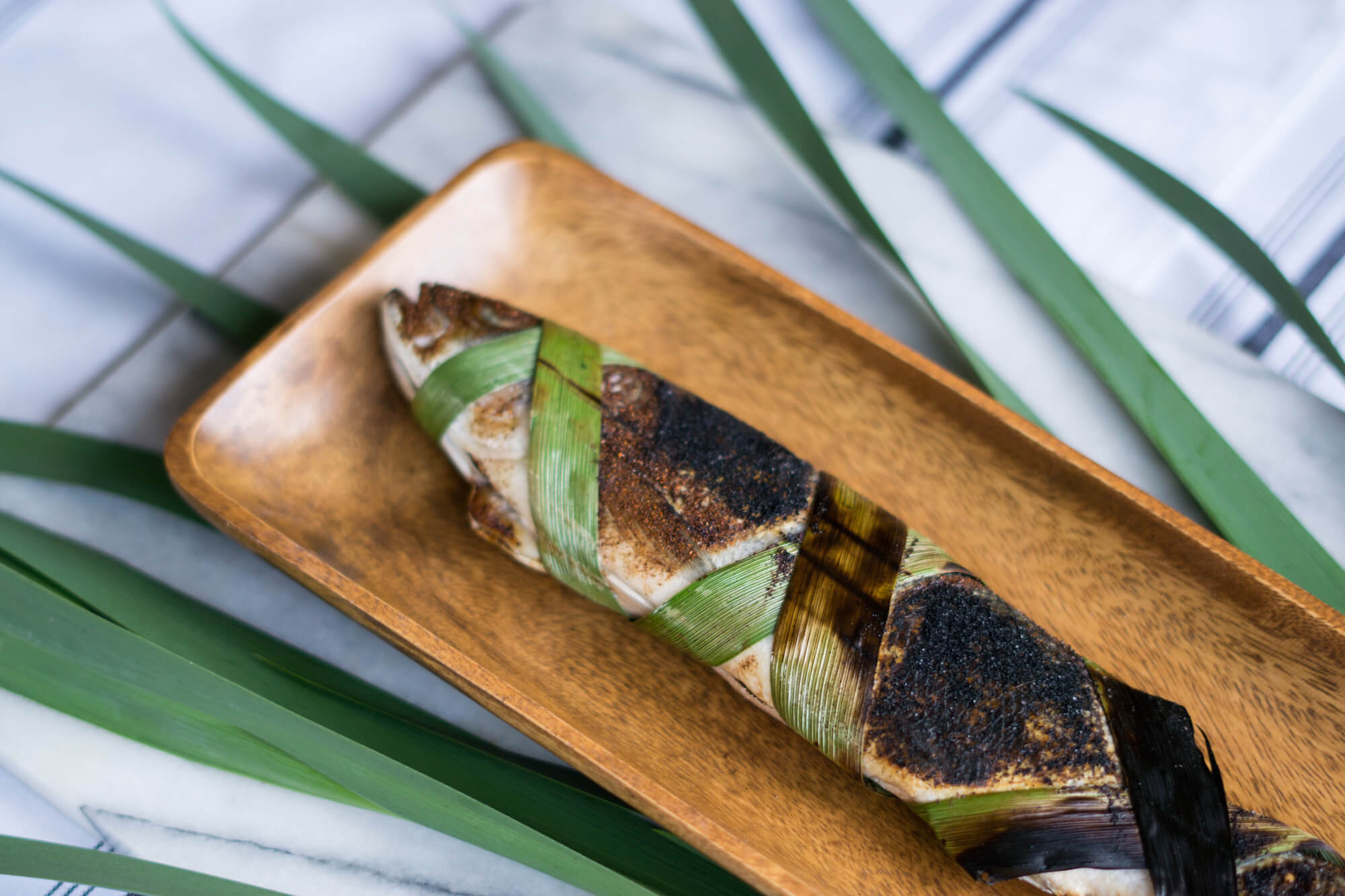 Recipe for simple grilled fish using tropical leaves and fish from the Amazon River