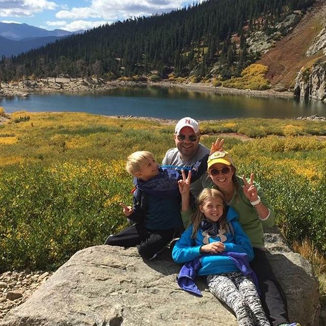 erin and family hiking in a meadow