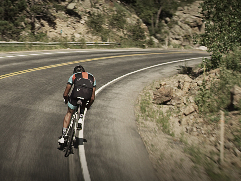 Road Cyclist Descending on a Mountain Road